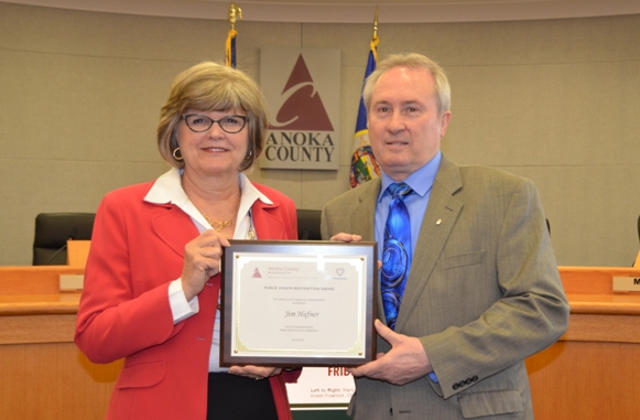 Anoka County Commissioner Robyn West presents Jim Hafner (Blaine Stormwater Pollution Prevention and Wellhead Protection Manager) with the 2014 Public Health Leadership Award.