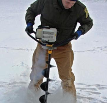 DNR Fisheries Specialist Jim Levitt angering a hole in lake to collect samples and monitor water quality.